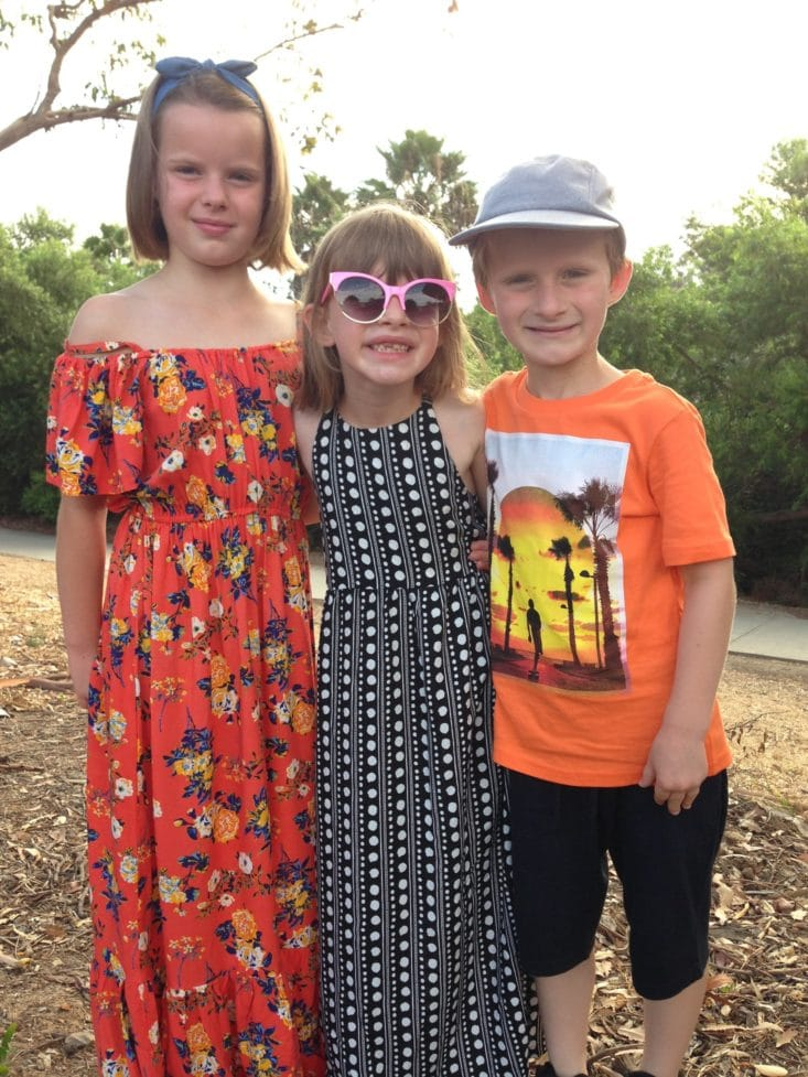Two girls and a boy wearing on-trend clothes and accessories from Fabkids