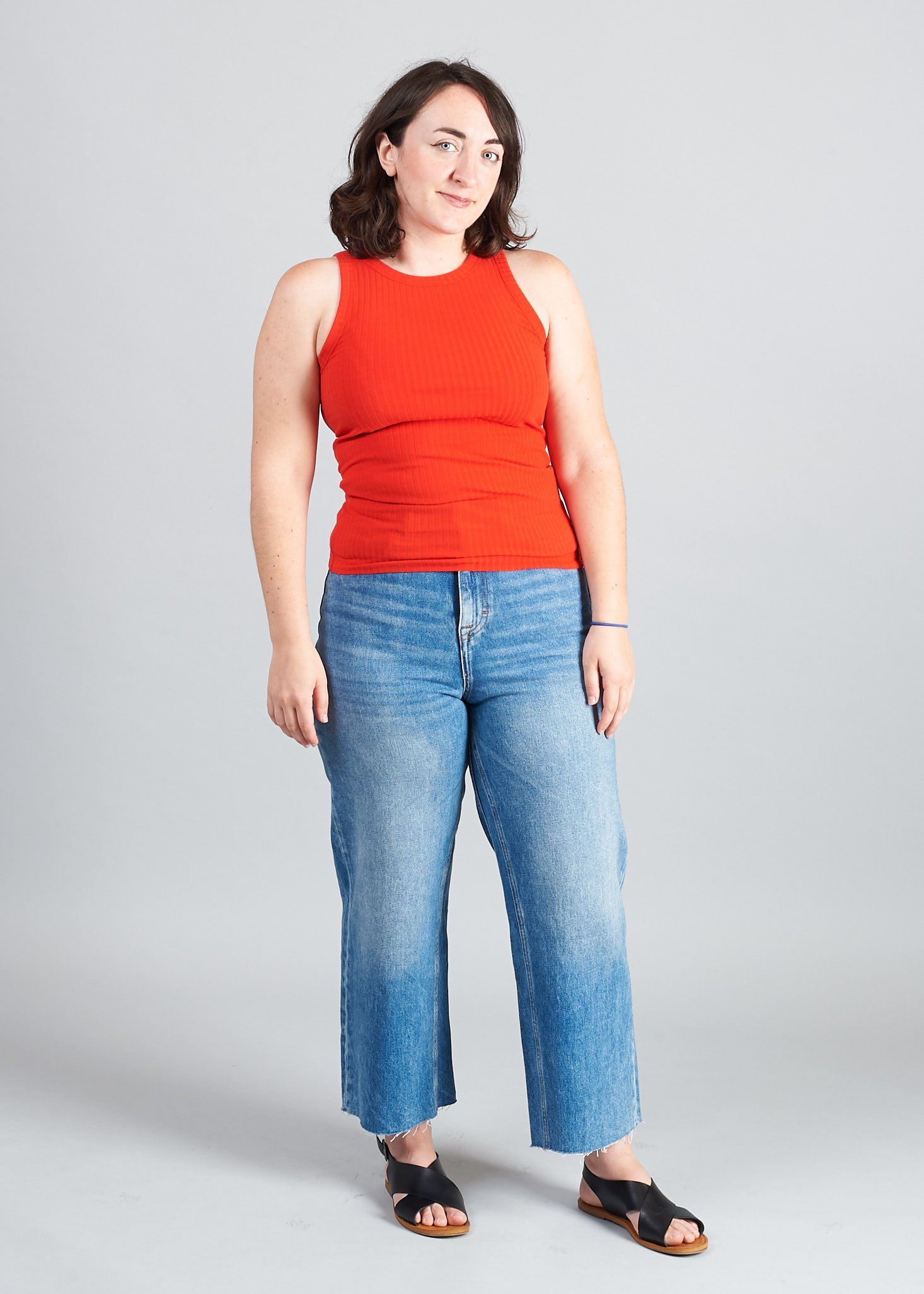 me wearing my red frank and oak tank and wide leg jeans