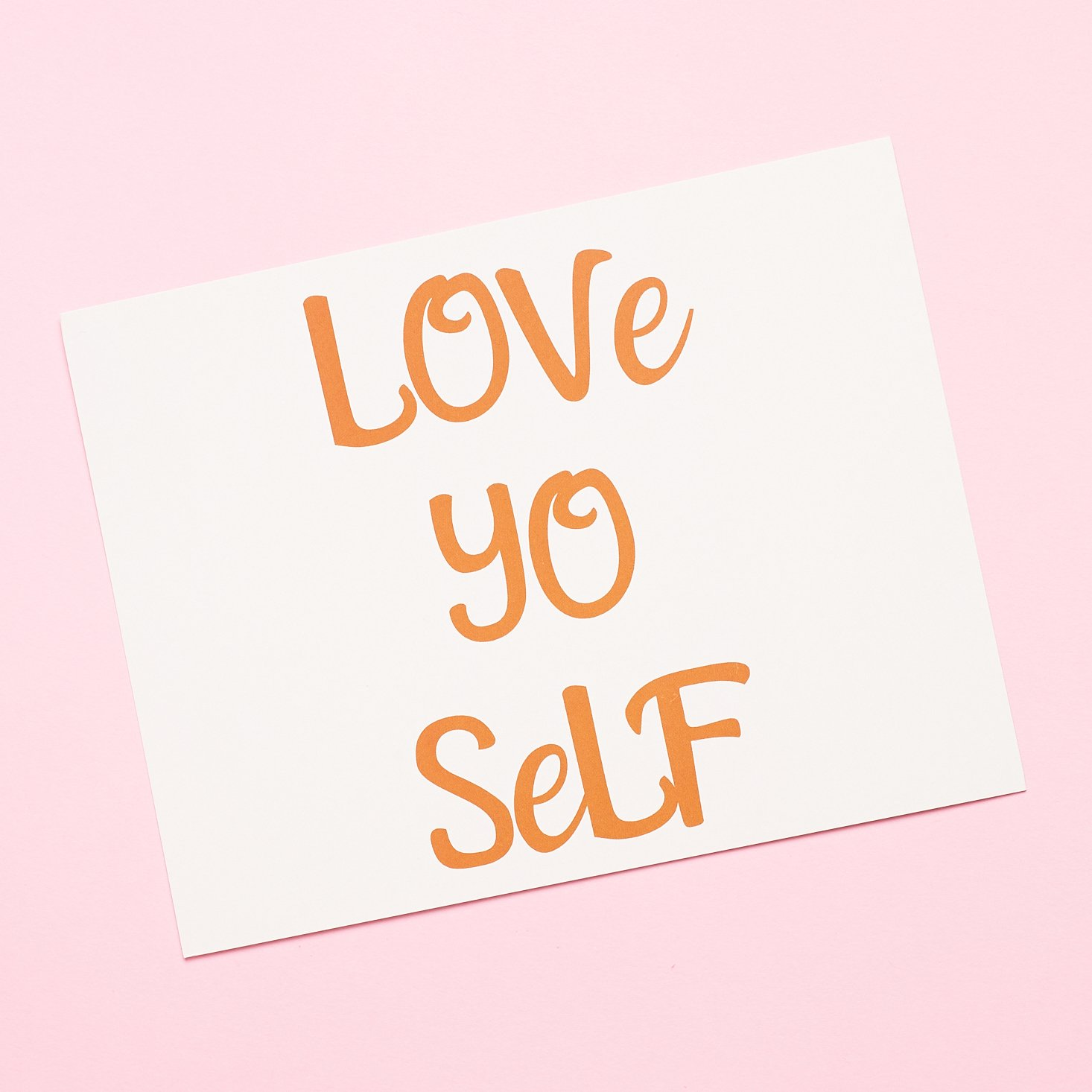 "Front of product info card that says ""Love Yo Self"""
