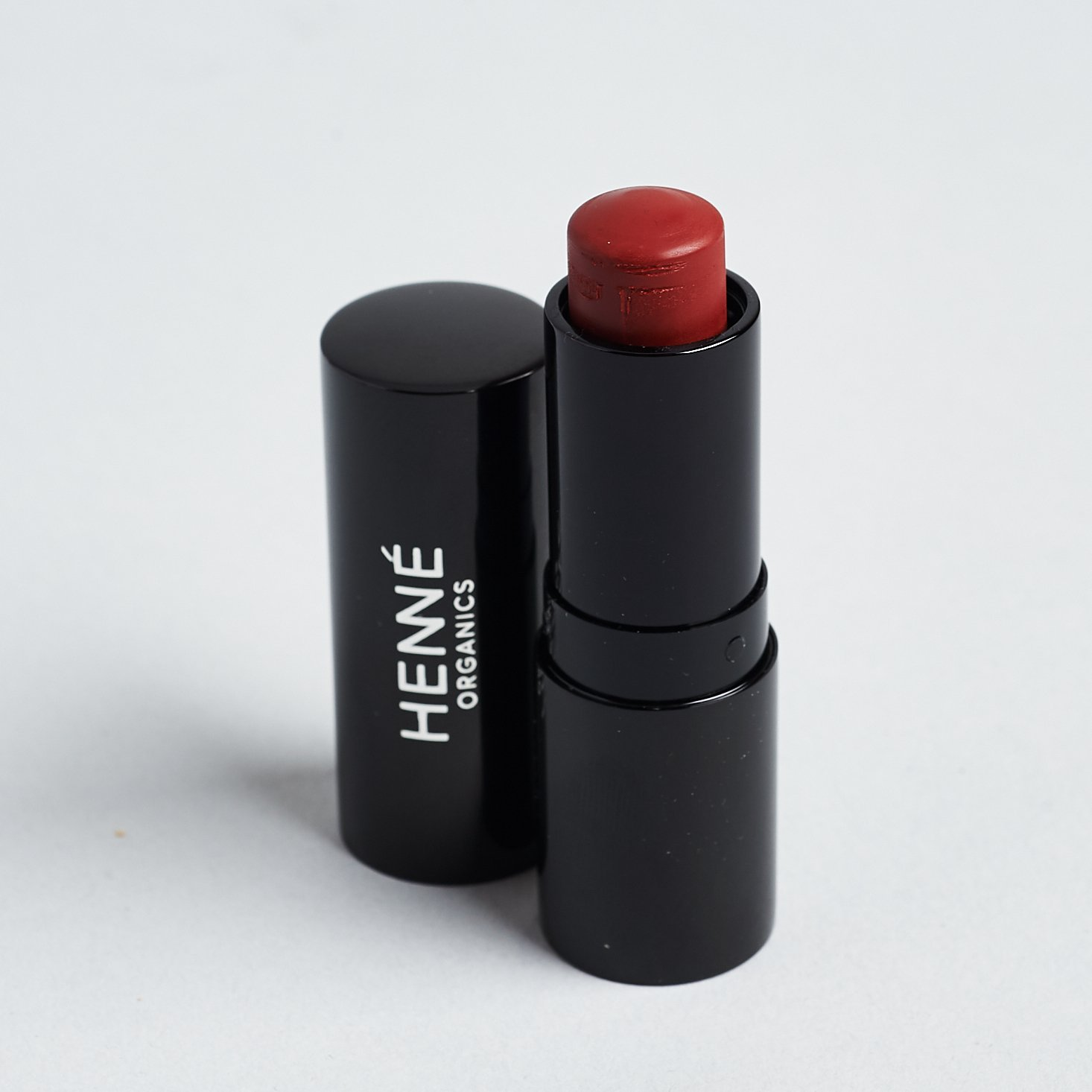 """Henne Organics Luxury Lip Tint in """"Intrigue"""" with lid off"""