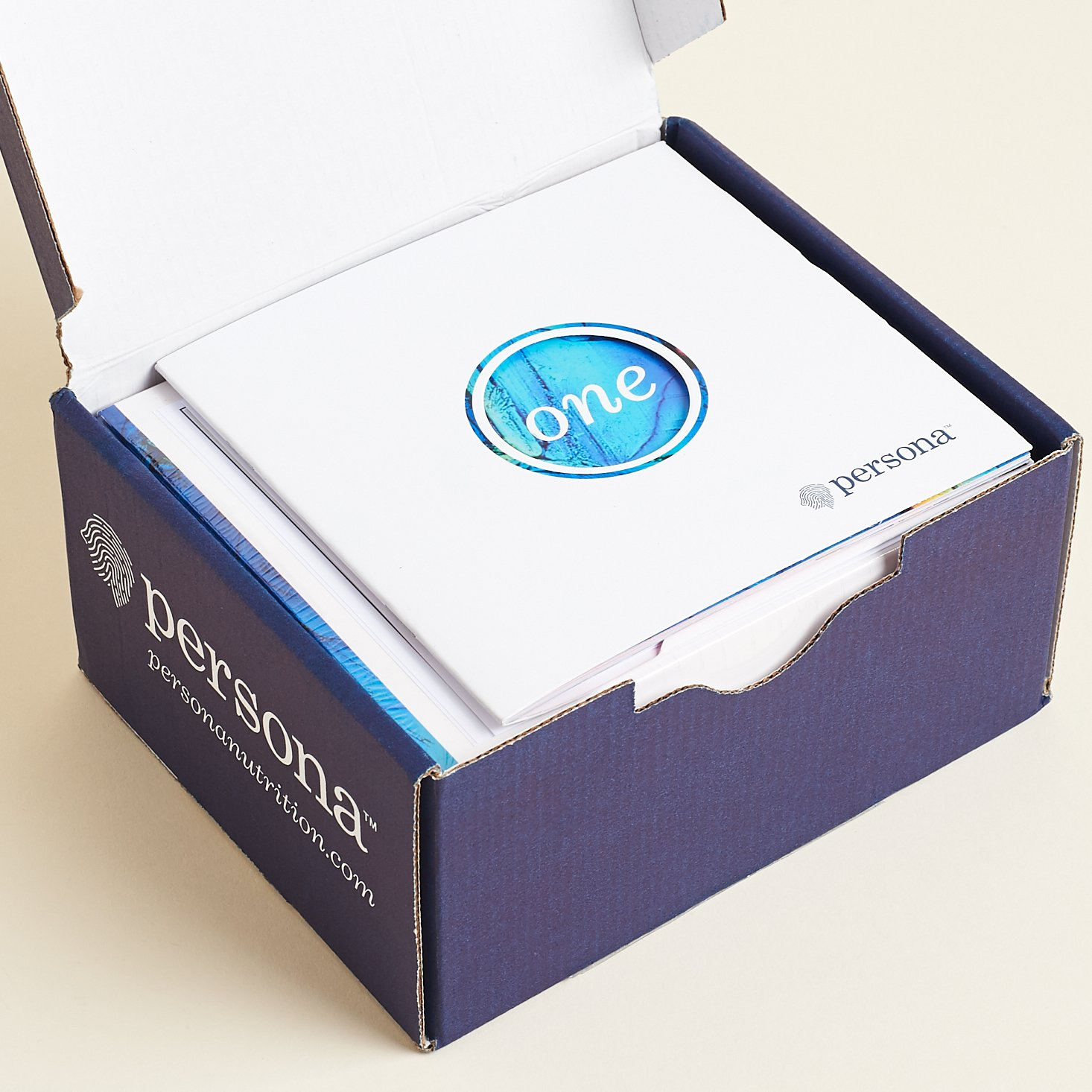 Open Persona box with booklet on top