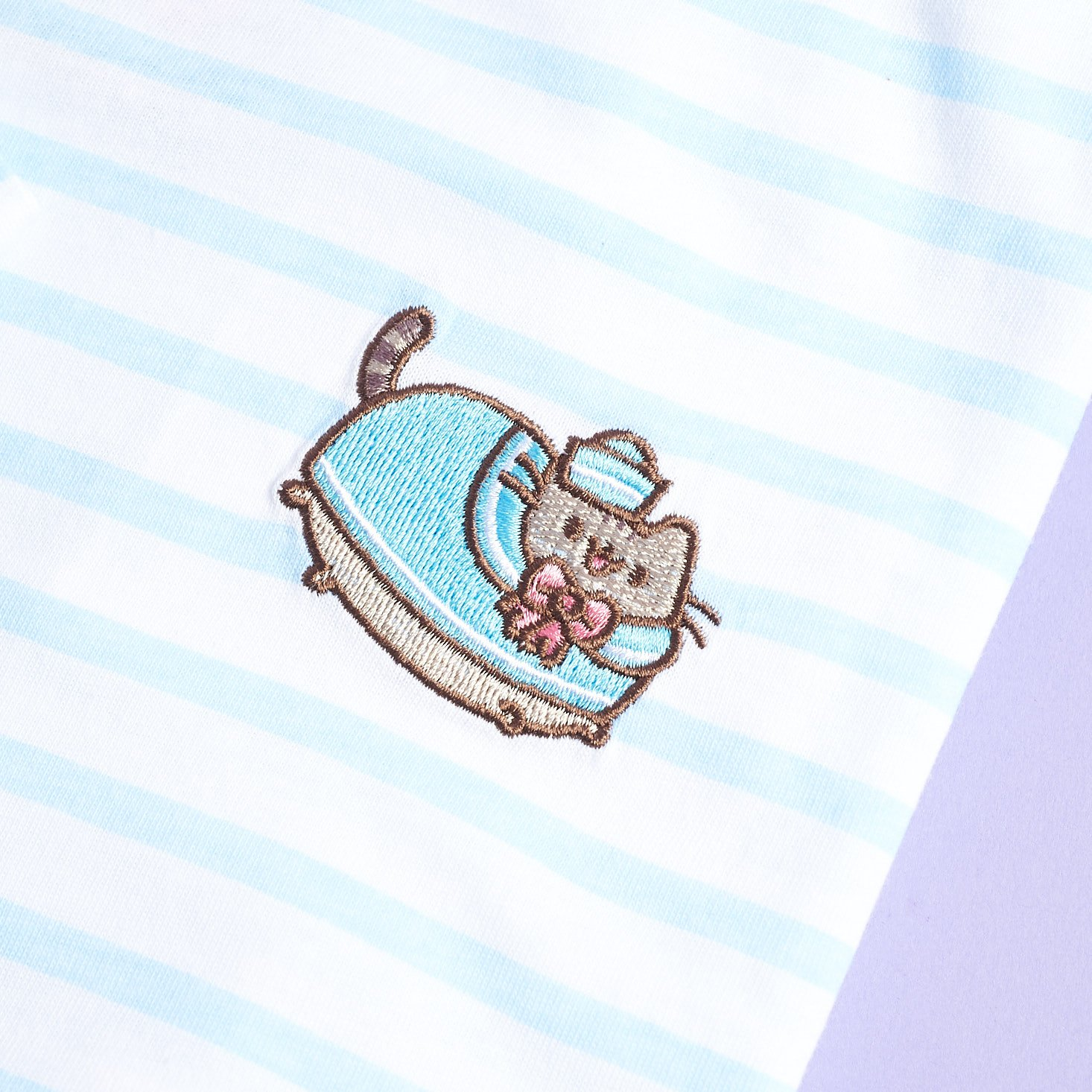 close up of embroidered Pusheen on Long sleeve striped Pusheen Sailor tee