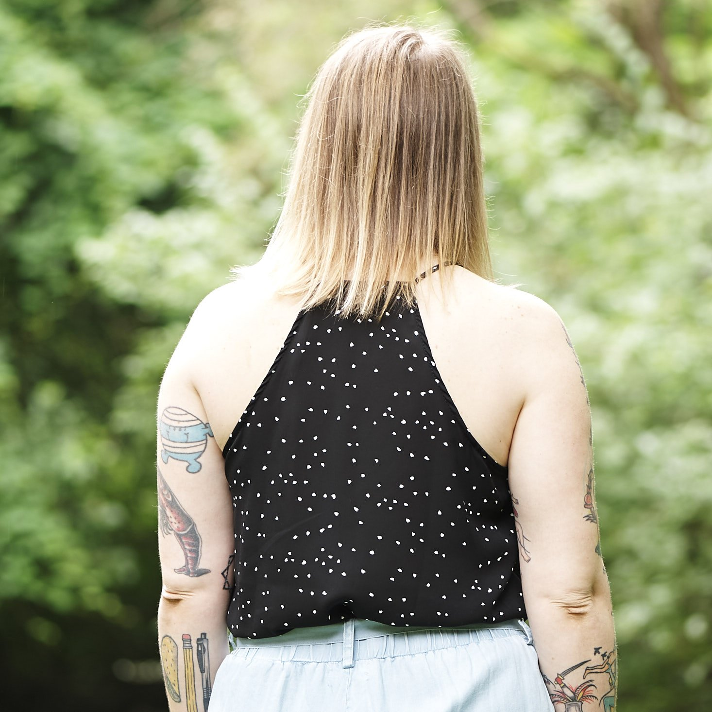 Close up of Marne wearing polka dot camisole - back