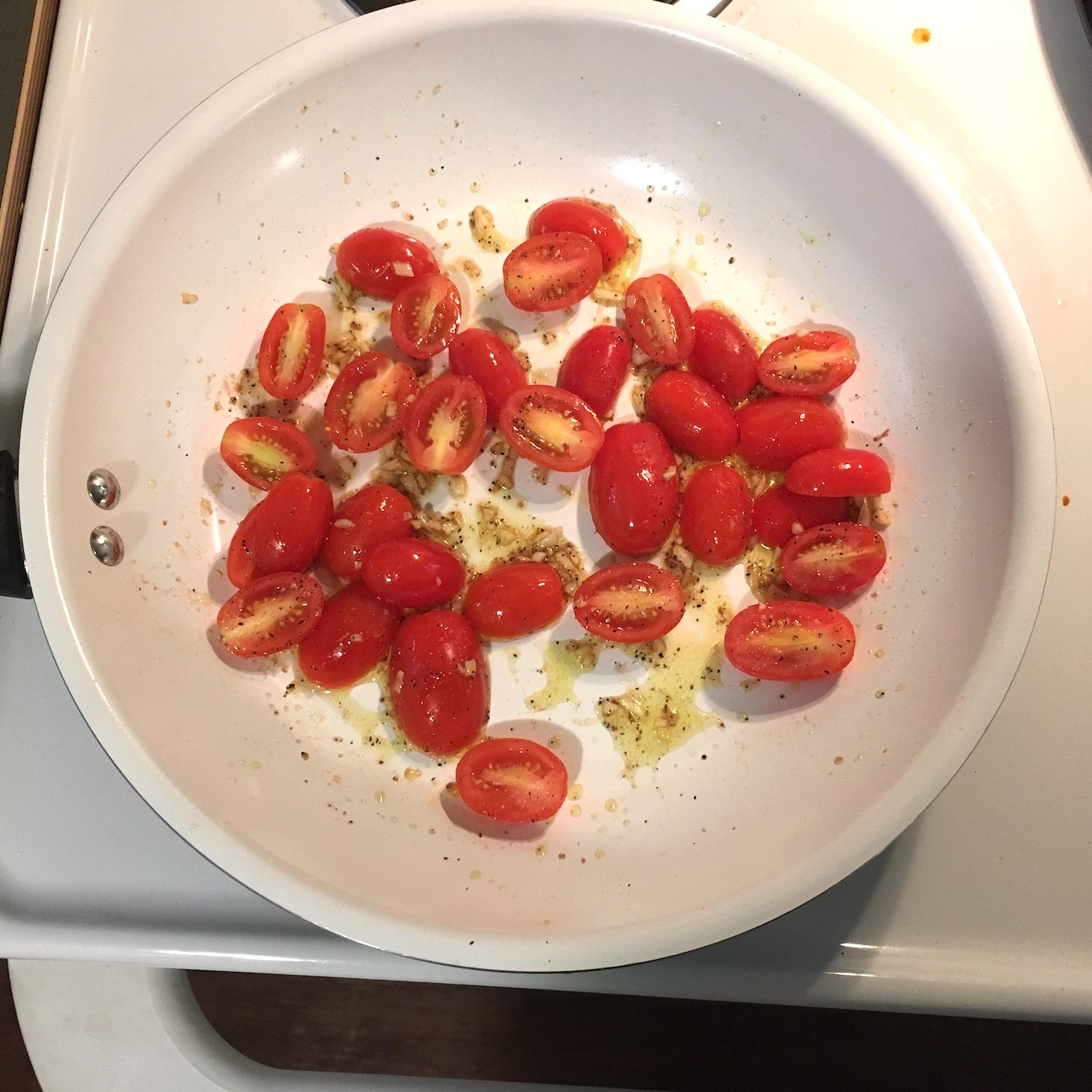tomatoes cooking in pan