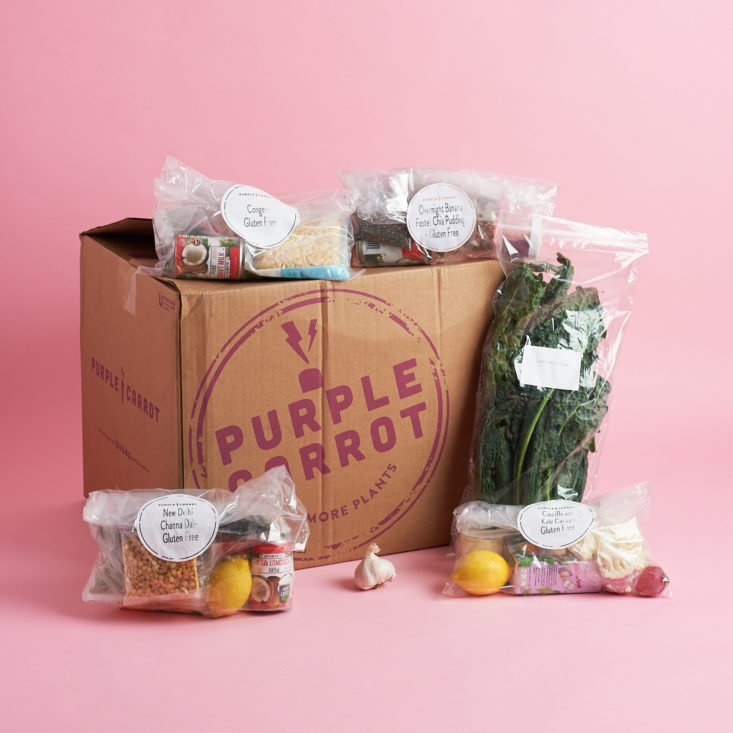 Ingredients packaged and surrounding a cardboard box from Purple Carrot
