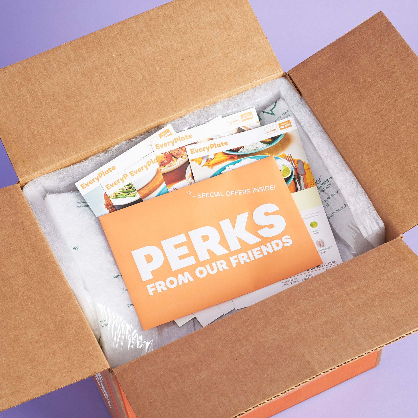 Perks coupons on top of open box