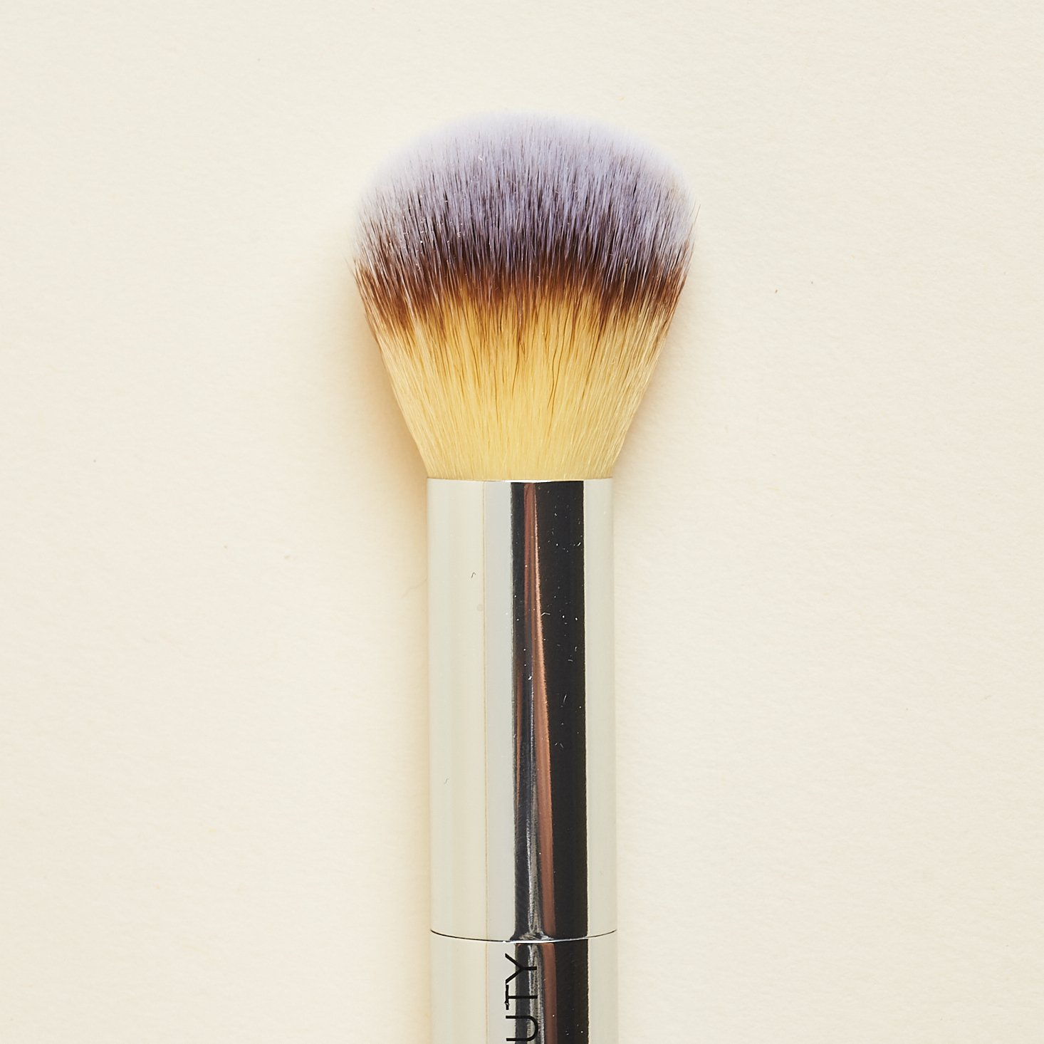 close up of rounded end of Fitglow Beauty Teddy Double Cheek Brush