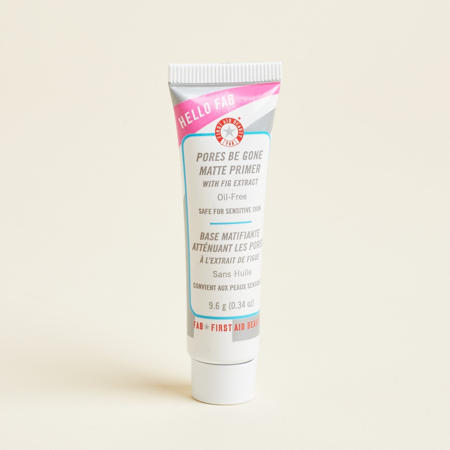tube of primer with pink, red, blue, and silver design