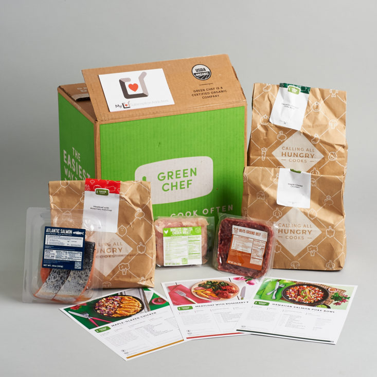 Green Chef box with three meals and their recipes unpacked from the box.