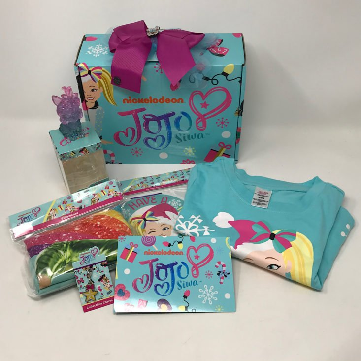 A collection of merchandise from the December 2019 Jojo Siwa Box.