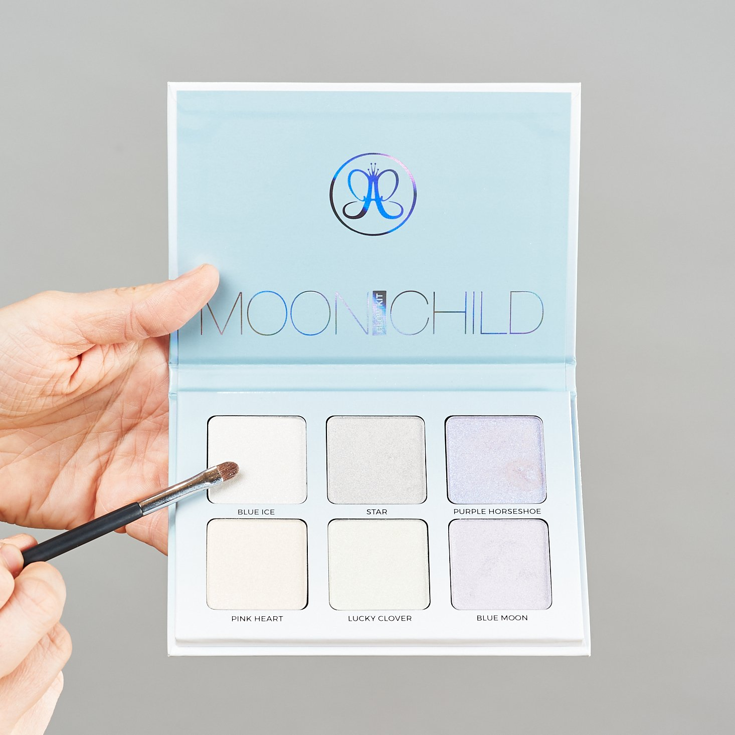 Moonchild Glow Kit from Anatasia Beverly Hills with brush pointing to Blue Ice