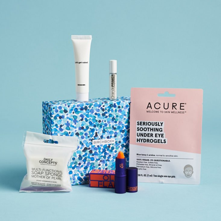Birchbox subscription with lipstick, hydrogels, and more featured outside the box.