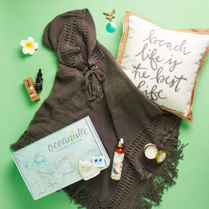 Oceanista box with poncho, pillow, and other items shown.