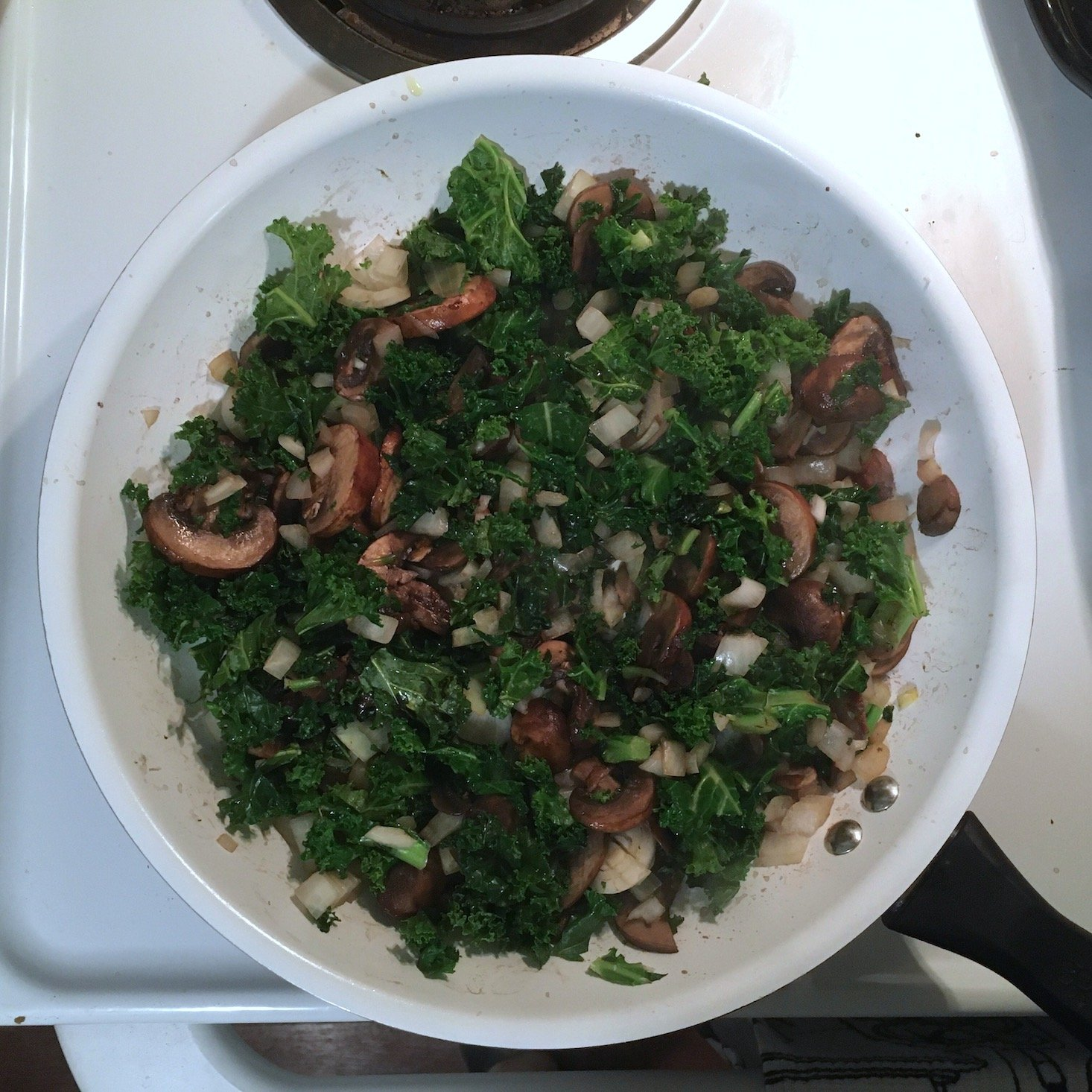 Home Chef February 2020 - mushroom and kale pie mushrooms and kale in pan