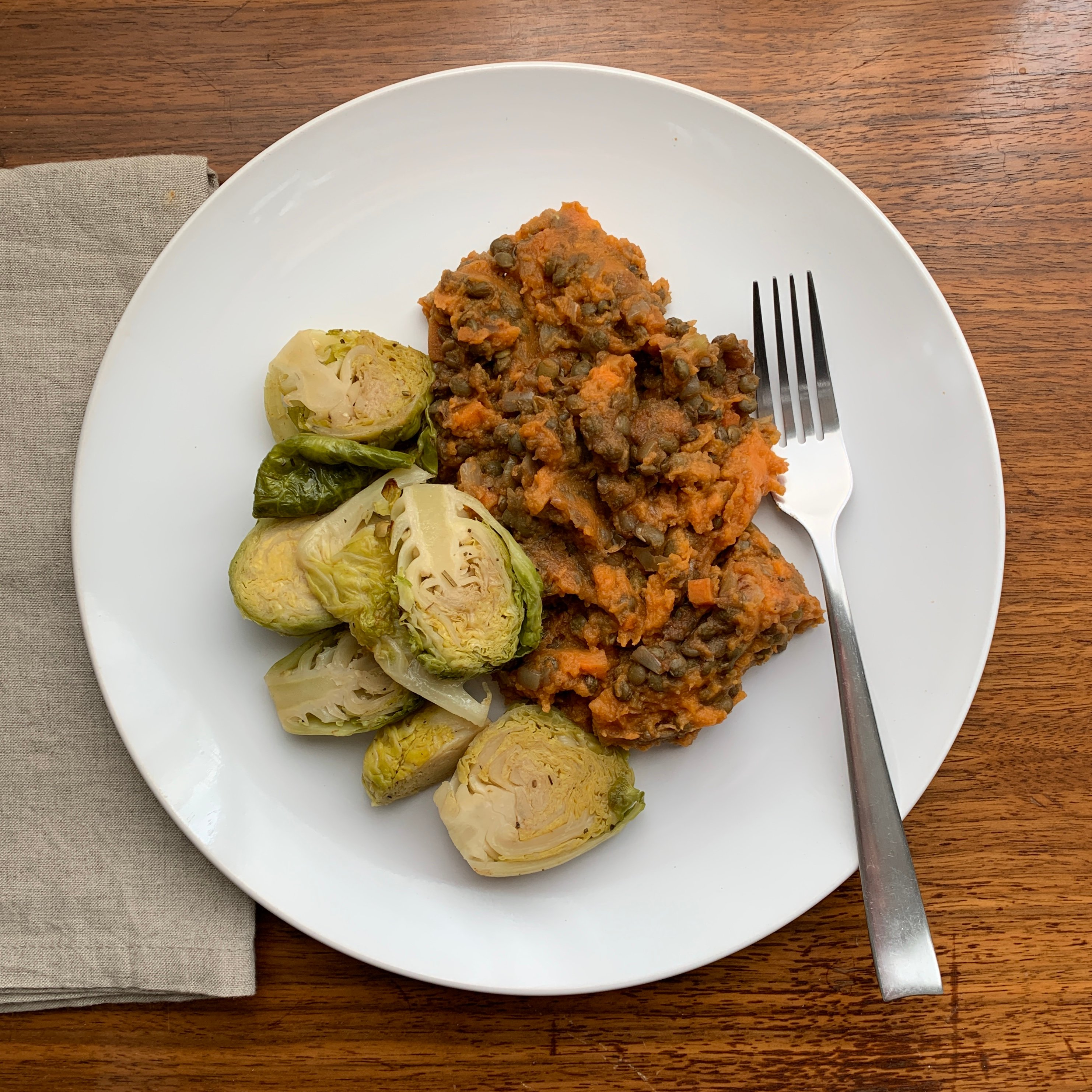 Spiced Lentils with Sweet Potato Mash on plate
