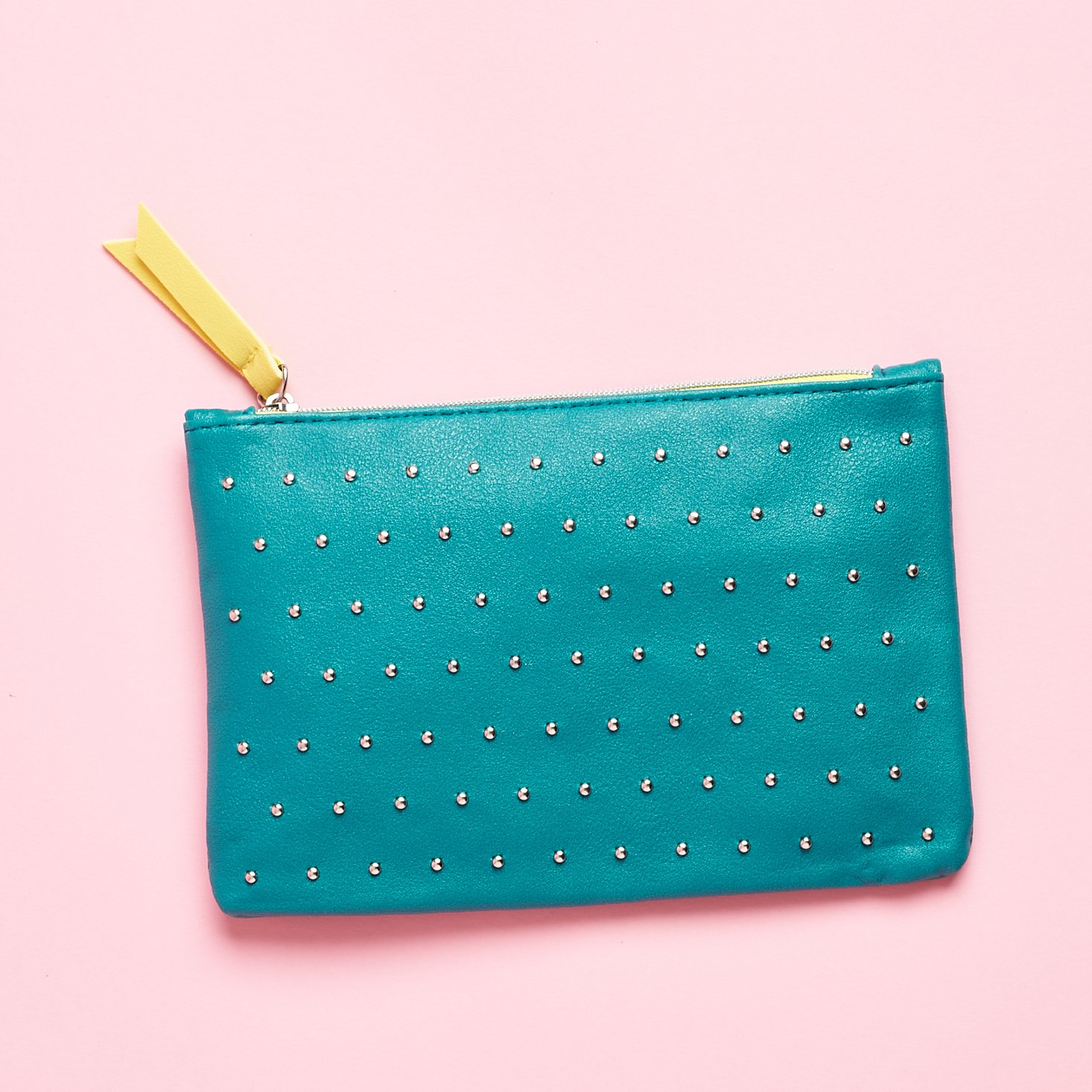 faux leather teal back with studded detail and lime interior