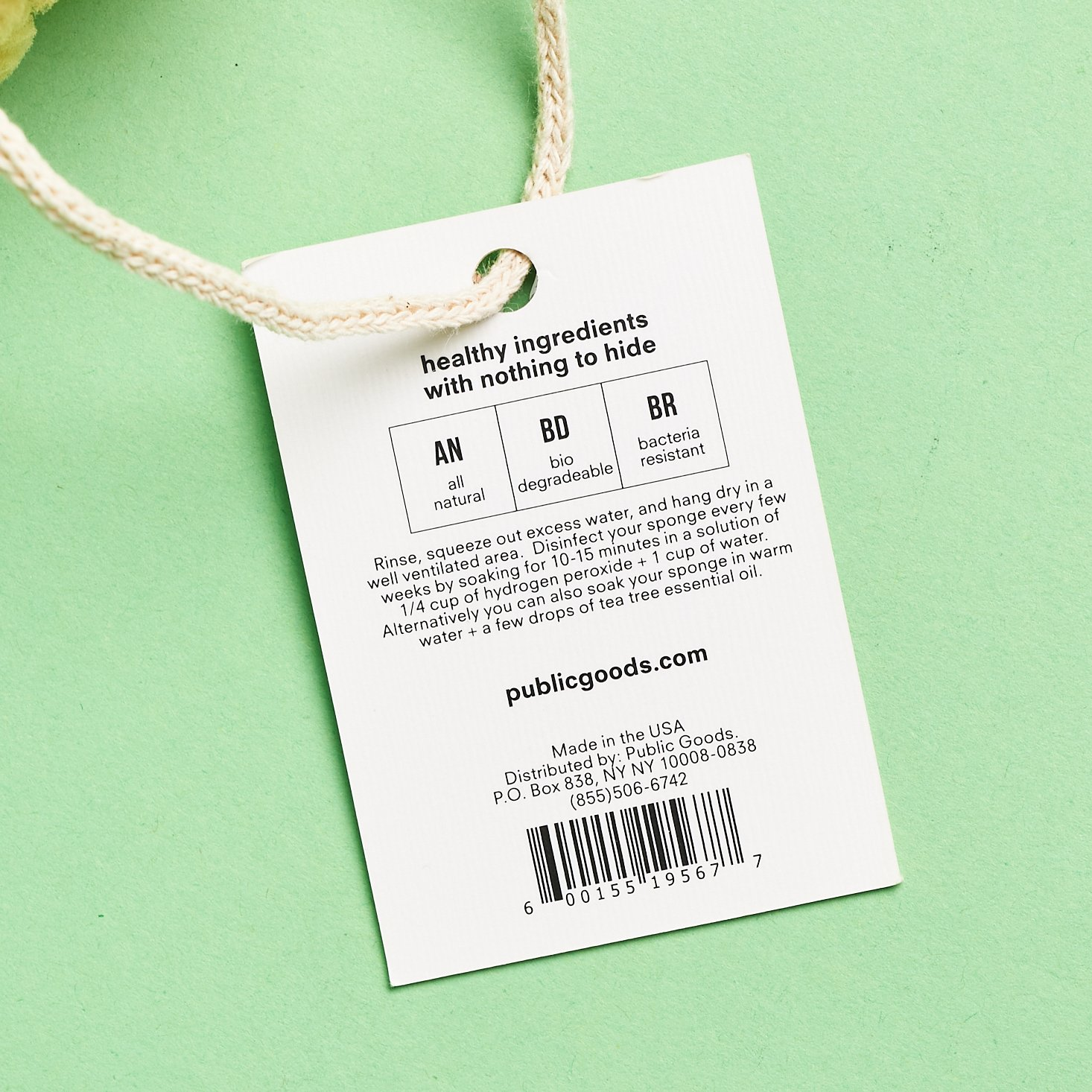 close up of tag for Public Goods Sea Sponge