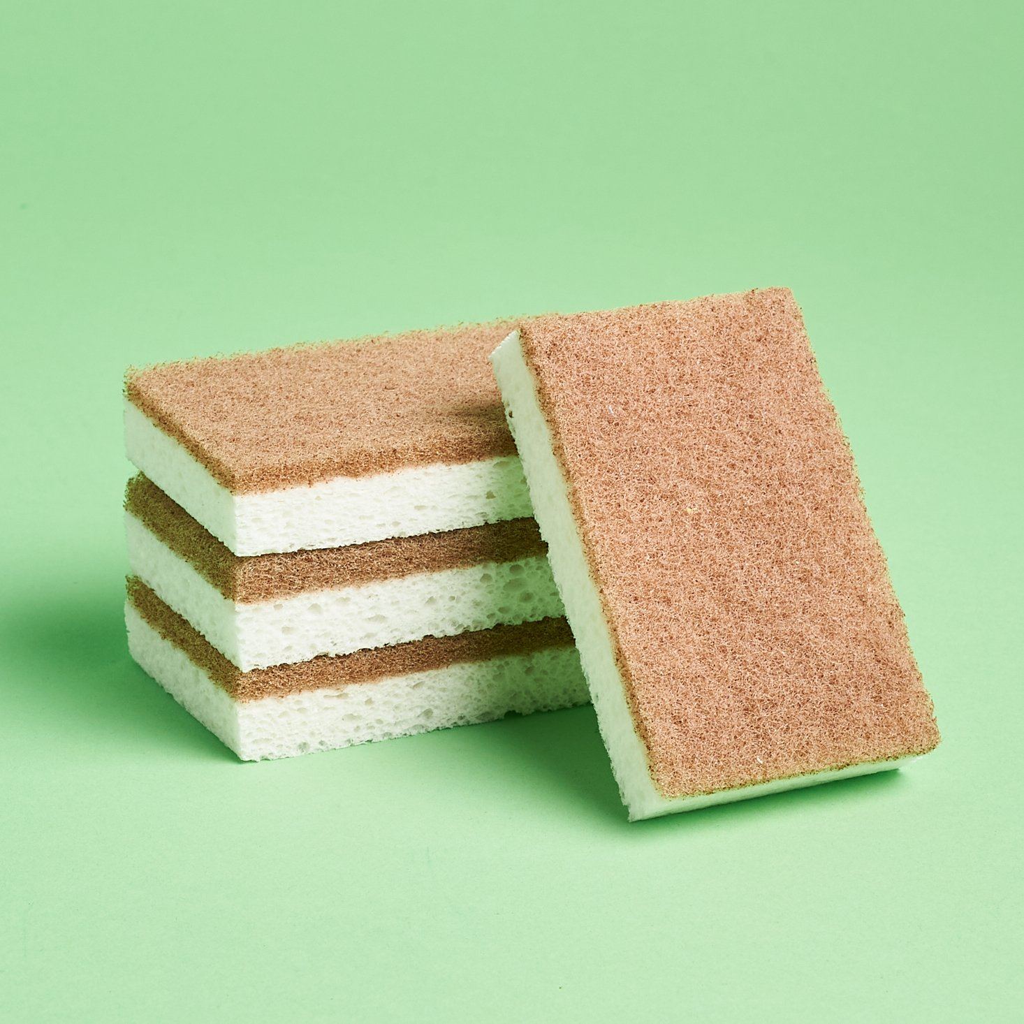 Public Goods Scrubber Sponges out of package with one sponge leaning in front