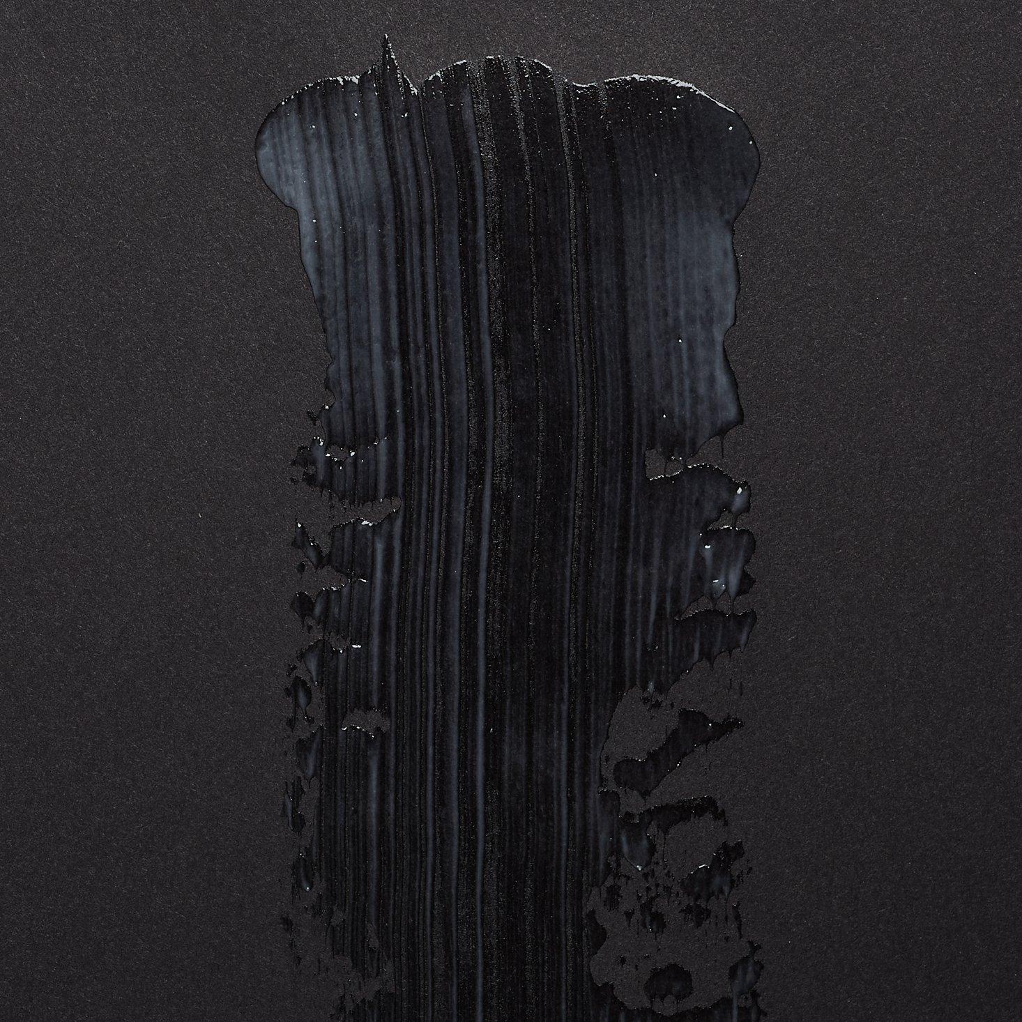 Lume deodorant on black paper.