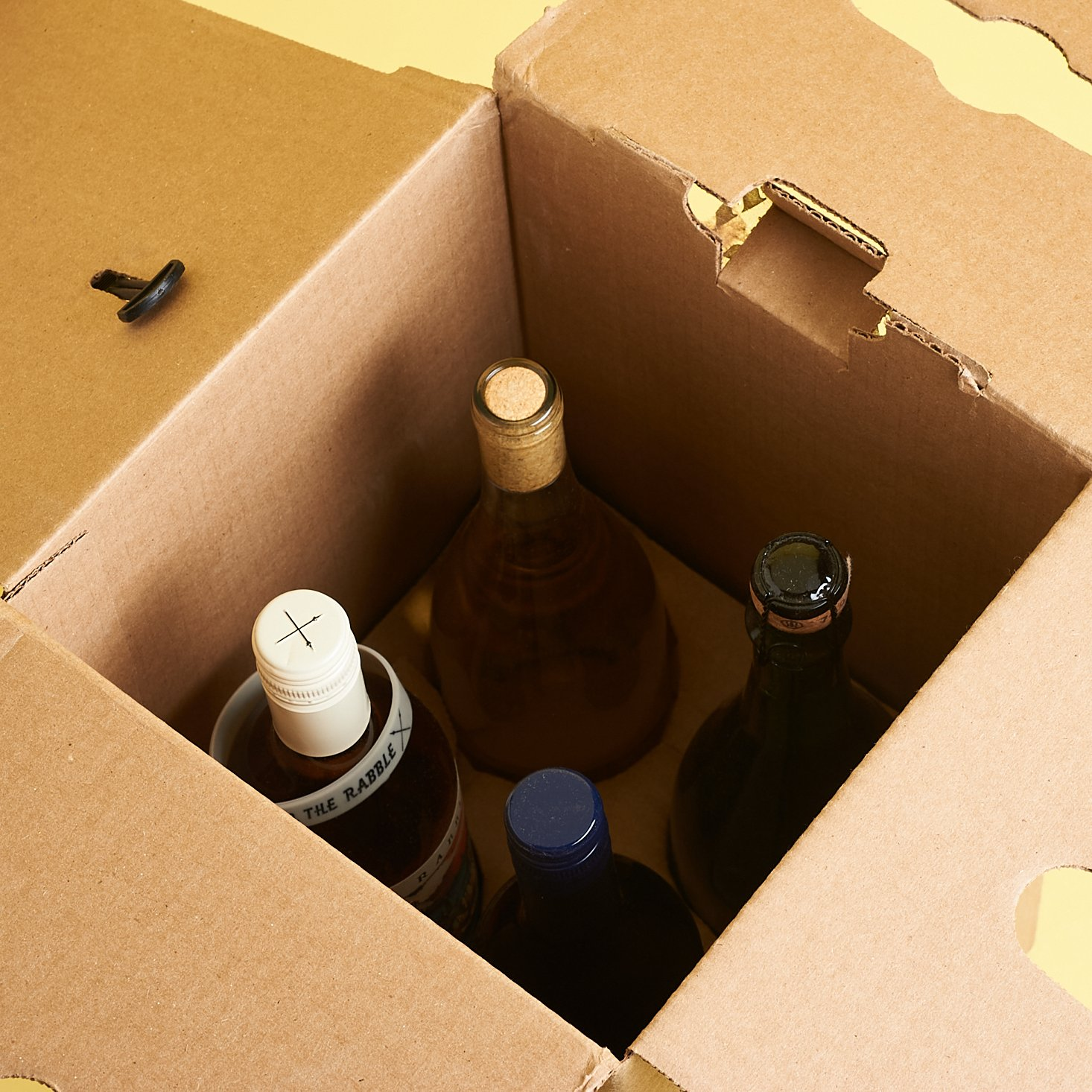 view of four upright bottles inside of the box