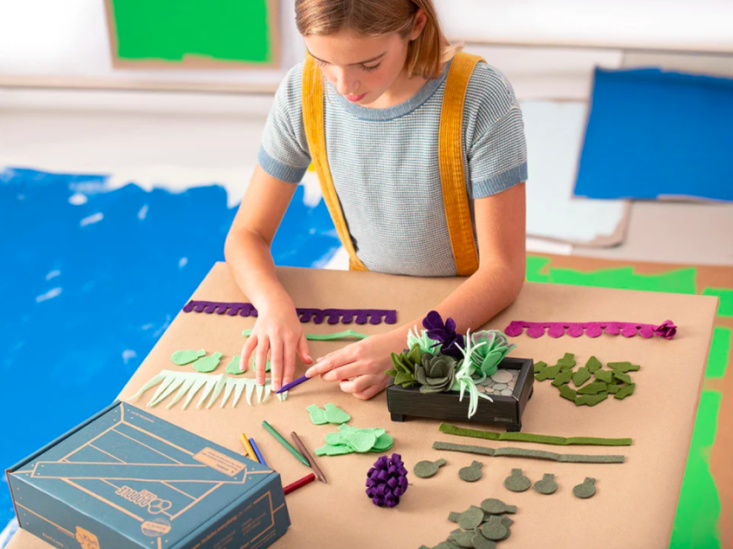 Young person making a felt garden using Doodle Crate supplies.