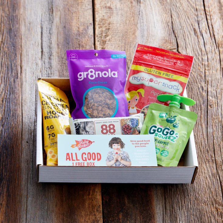 Box filled with healthy snacks for kids.