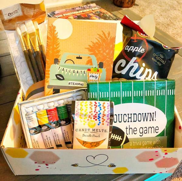 Bonding Bees Box with snacks, art supplies, and trivia activities