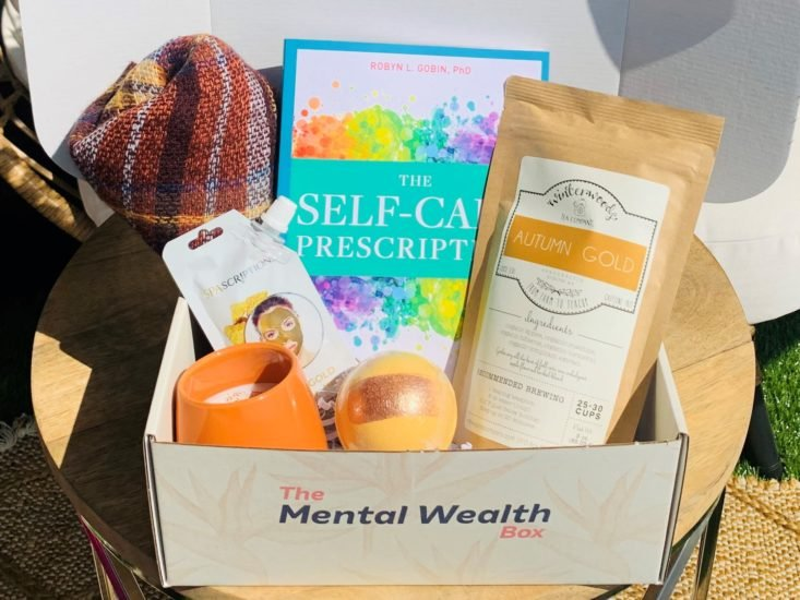 The Mental Wealth Box, open to show all contents.
