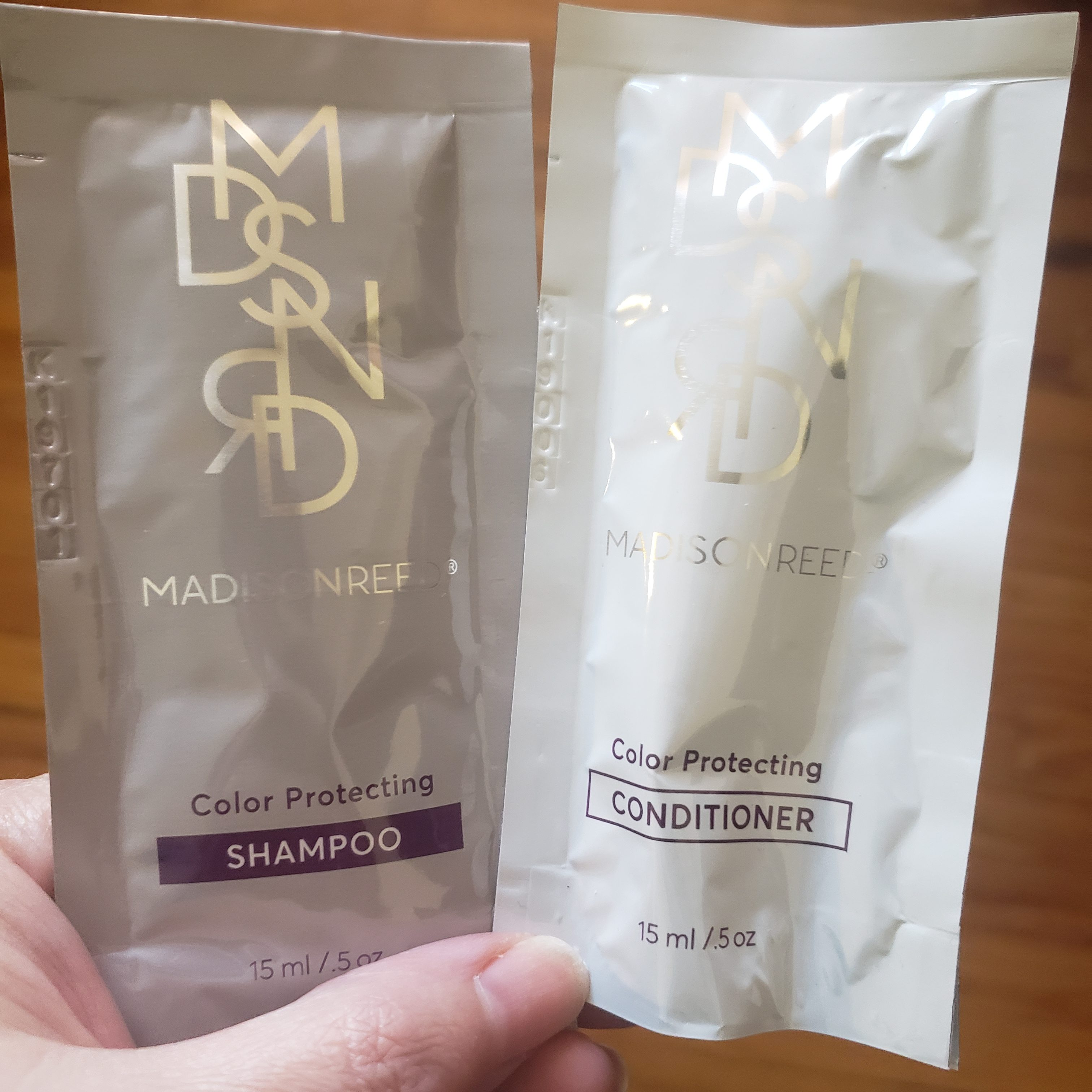 Unopened packets of Madison Reed shampoo and conditioner