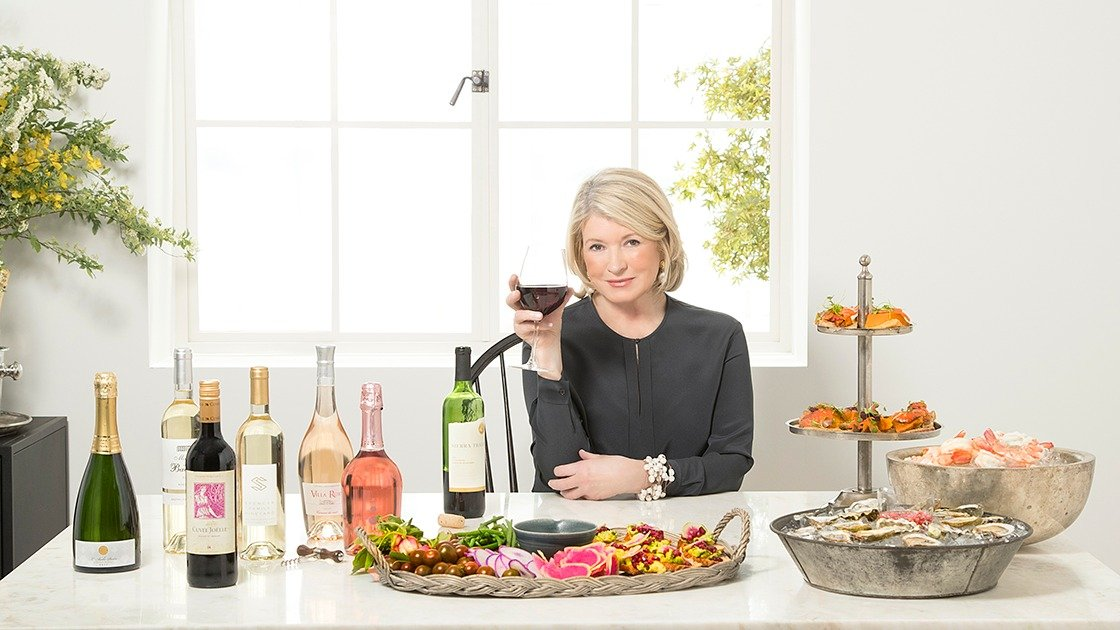 Photo of Martha Stewart with wines and food