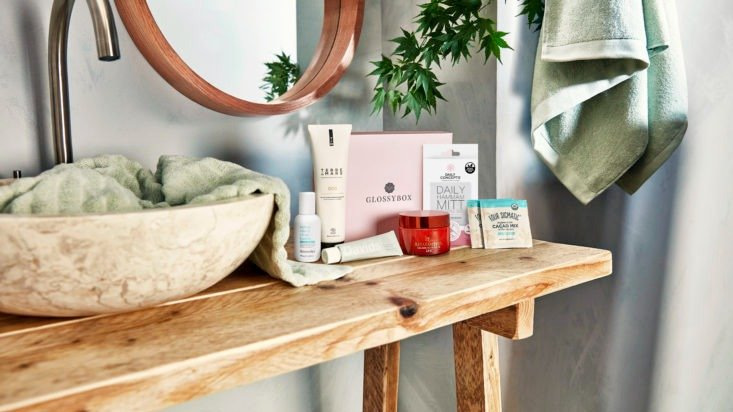 Photo of September Glossybox products on wood shelf
